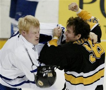 Wade Belak knocks helmet off Bruins' Doug Doull.
