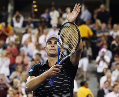 Roddick celebrates his win over compatriot Russell during their match at the U.S. Open tennis tournament in New York