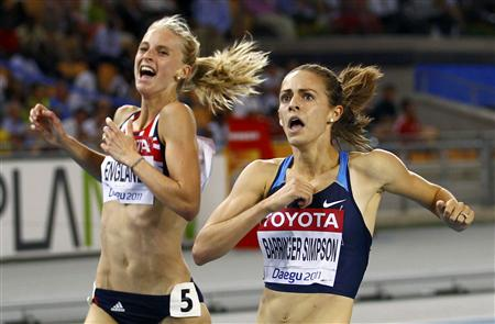 Jennifer Barringer Simpson of the U.S. celebrates winning the women's 1500 metres final next to Hannah England of Britain in Daegu
