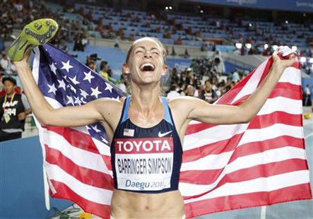 Jennifer Barringer Simpson celebrates winning the women's 1,500 metres final at the IAAF World Championships in Daegu