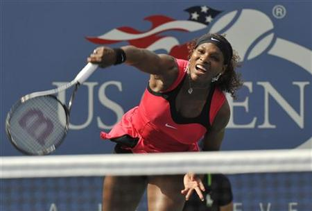 Serena Williams of the U.S. hits a serve to Michaella Kajicek of the Netherlands during their match at the U.S. Open tennis tournament in Ne