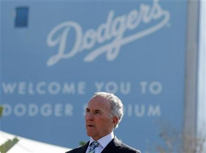 Los Angeles Dodgers owner Frank McCourt listens at a news conference about increased security at Dodger Stadium in Los Angeles