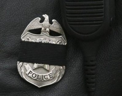 Police badge with black band (Reuters)