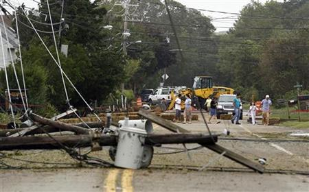 Residents inspect fallen power lines in Hampton Bays, New York