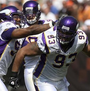 Minnesota Vikings Williams celebrates with teammates after sacking Cleveland Browns Quinn in Cleveland