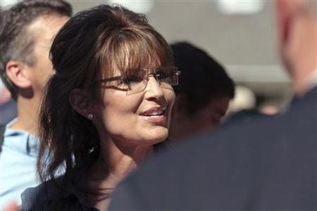 "Former Alaska governor Sarah Palin greets supporters as she arrives for the premiere of a documentary about her entitled ""The Undefeated"" in"