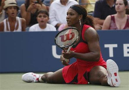Serena Williams of the U.S. does the splits after making a shot against Victoria Azarenka of Belarus during their match at the U.S. Open ten