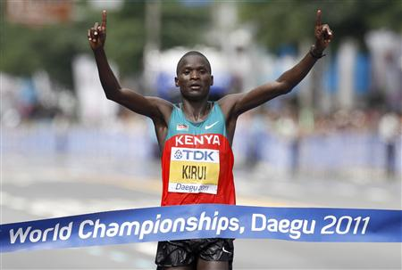 Kirui of Kenya celebrates winning the men's marathon at the IAAF World Athletics Championships in Daegu