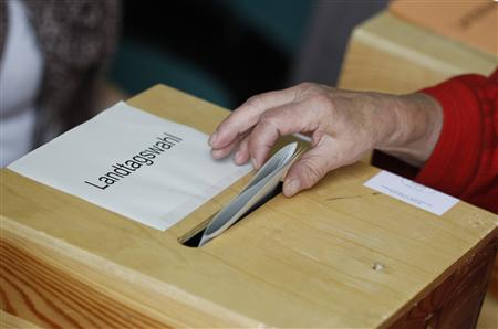 A woman casts her vote in Mecklenburg-Vorpommern state election in polling station in Neustrelitz
