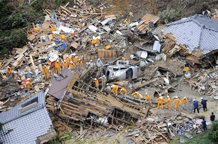An aerial view shows firefighters searching among collapsed houses following a landslide caused by strong tropical storm Talas in Tanabe, in