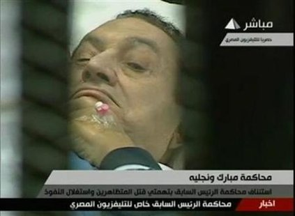 Former Egyptian President Hosni Mubarak is seen in the courtroom during his trial at the police academy in Cairo in this still image taken f