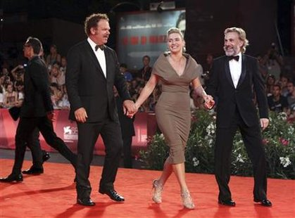 "Actors Winslet, Reilly and Waltz pose for photographers as they arrive on the ""Carnage"" red carpet at the 68th Venice Film Festival in Venic"