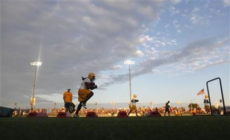 NFL Super Bowl Champions Green Bay Packers take the field for the first training camp practice of the year in Green Bay