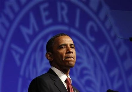 President Barack Obama pauses during the 93rd annual American Legion National Convention in Minneapolis