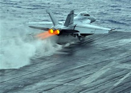 US Navy handout photo of an F/A-18 being catapulted off the USS Enterprise in the Red Sea