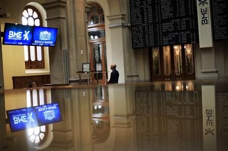 A trader looks at a computer screen at Madrid's bourse