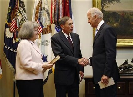 U.S. Vice President Joe Biden shakes hands with David Petraeus in Washington