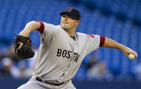 Boston Red Sox pitcher Jon Lester throws against the Toronto Blue Jays during their MLB baseball game in Toronto