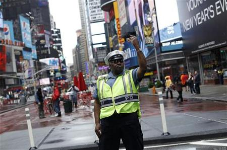 A police officer gestures as he works in New York's Times Square