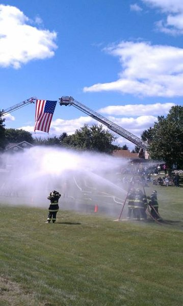 Labor Day Jess Kelley join the Cedar Grove Fire Department for the 100th Anniversary.