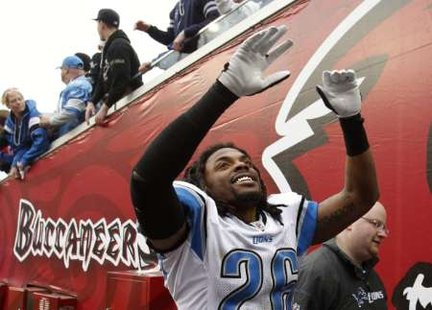 Detroit Lions safety Louis Delmas (26) celebrates the Lions overtime victory over the Tampa Bay Buccaneers in Tampa, Florida December 19, 2010.  The win ended Detroit's NFL record 26-game road losing streak.  The Lions open their 2011 season in Tampa.  REUTERS
