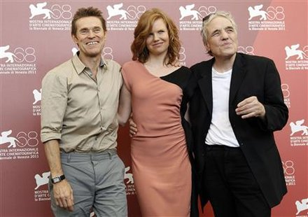 "U.S. director Ferrara and actors Leigh and Dafoe smile during photocall for film ""4:44 Last Day on Earth"" at 68th Venice Film Festival"