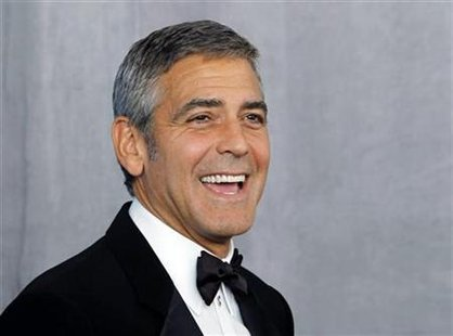Actor Clooney poses backstage after receiving the Bob Hope Humanitarian Award at the 62nd annual Primetime Emmy Awards in Los Angeles