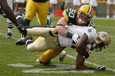 New Orleans Colston is tackled by Green Bay Packers Hawk on a five yard pass in the fourth quarter of their NFL football game at Lambeau Fie