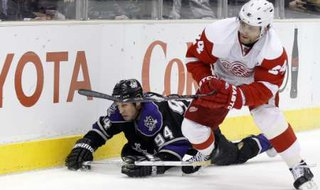 Detroit Red Wings Ruslan Salei (R) fights for the puck with Los Angeles Kings Ryan Smyth during their NHL game in Los Angeles, California February 28, 2011. REUTERS/Lucy Nicholson (UNITED STATES - Tags: SPORT ICE HOCKEY)