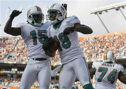 Miami Dolphins Davone Bess celebrates with teammate Brandon Marshall after Marshall scored a touchdown against the Buffalo Bills during four