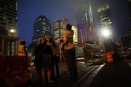 Visitors look at the World Trade Center site in New York