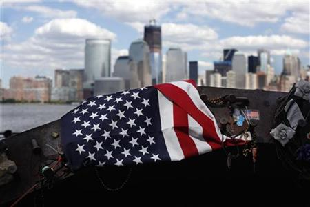 A U.S. flag is seen on a twisted piece of steel from the September 11th attacks on the World Trade Center, is seen at a memorial site across
