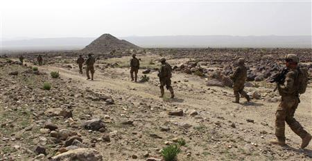 U.S. soldiers from Task Force Bronco, 3rd Squadron, 4th Cavalry Regiment patrol to search for arms cache in Nangarhar