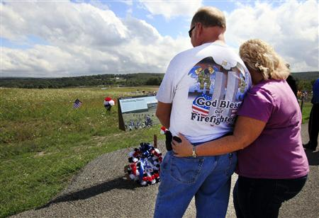 Dale and Ronda Dittrick of Dayton, Ohio, read a sign at the temporary memorial for Flight 93 outside Shanksville, Pennsylvania