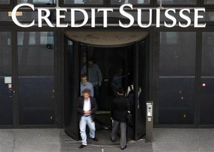 Employees enter and leave a Credit Suisse building in Zurich