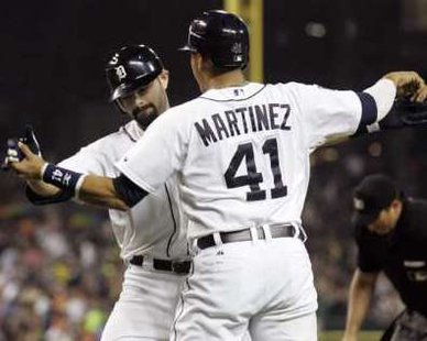 Detroit Tigers Alex Avila celebrates at home-plate with teammate Victor Martinez after hitting a three-run home run against the Minnesota Twins during the second inning of their MLB American League Baseball game in Detroit, Michigan, September 9, 2011. REUTERS/Rebecca Cook