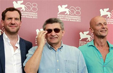 Director Alexander Sokurov poses with actors Johannes Zeiler and Anton Adasinskiy during a photocall for Faust at the 68th Venice Film Festi