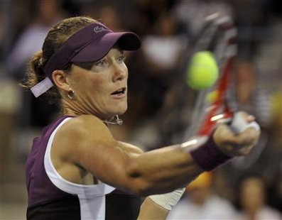 Samantha Stosur of Australia returns volley to Angelique Kerber of Germany during their semi-finals match at the U.S. Open tennis tournament
