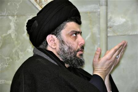 Anti-U.S. Shi'ite cleric Moqtada al-Sadr prays during his visit to the holy shrine of Imam Hussein in Kerbala