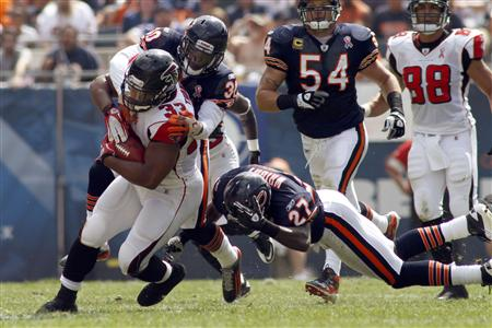 Falcons' Turner runs for a first down during their game against the Bears in Chicago
