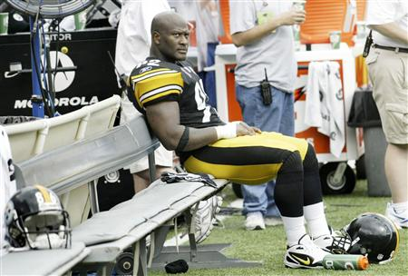 James Harrison of the Steelers sits alone on the bench during their NFL game against the Ravens in Baltimore