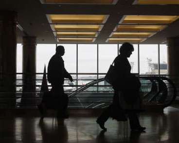 People walk through LaGuardia Airport in New York. REUTERS/Shannon Stapleton