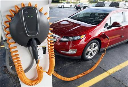 A 2012 Chevrolet Volt electric vehicle is parked at the solar-powered electric charging station designed by Sunlogics in the parking lot of