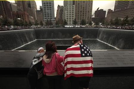 Family and friends of those who died on Sept. 11 visit the memorial in New York