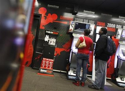 People play video games inside a GameStop retail store in New York