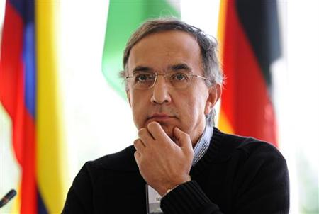Sergio Marchionne, chief executive officer of Fiat and marquee speaker reacts during the Spruce Meadows Changing Fortunes Round Table on bus