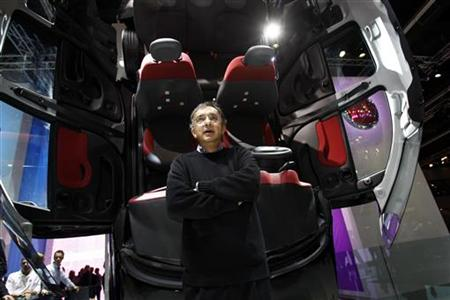 Fiat CEO Sergio Marchionne poses in front of a new Fiat Panda during the International Motor Show (IAA) in Frankfurt