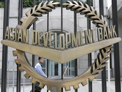 A worker walks past inside the Asian Development Bank headquarters in Manila