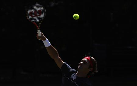 Roger Federer of Switzerland hits a ball during a practice session in Sydney