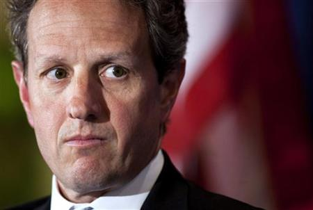 Timothy Geithner listens to questions at a media briefing with the U.S.-China Business Council in Washington